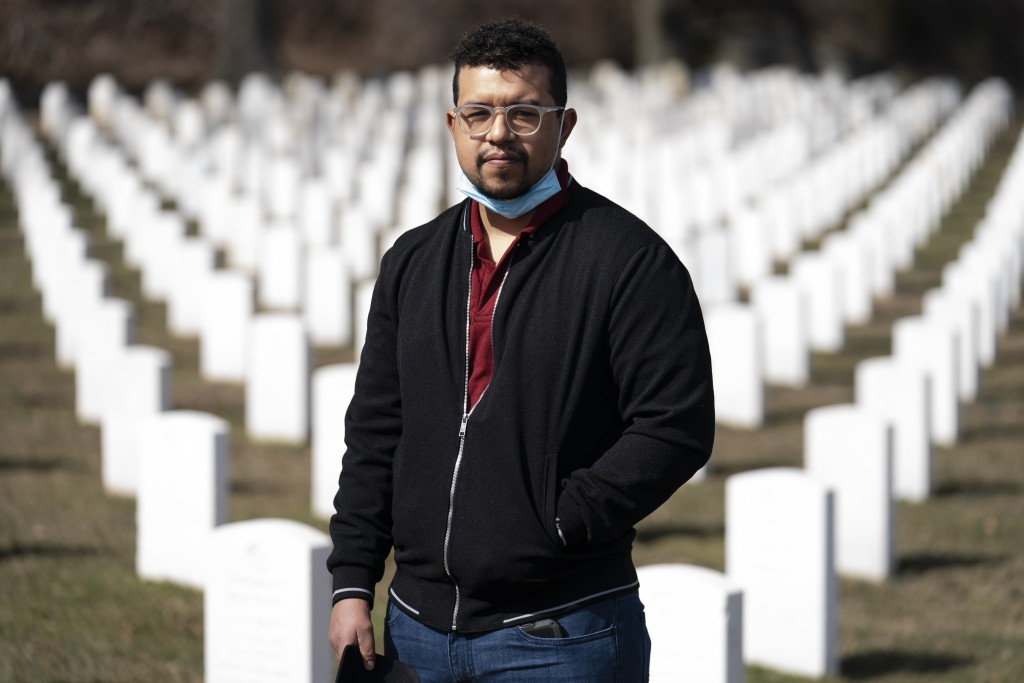 Undertaker Jesus Pujols stands for a portrait at Cypress Hills National Cemetery, Friday, March 12, 2021, in the Brooklyn borough of New York. Pujols ...