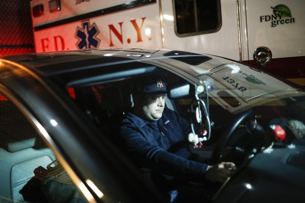 FILE - In this April 6, 2020, file photo, paramedic Travis Kessel is photographed outside his station house after working a shift amid the COVID-19 pa...