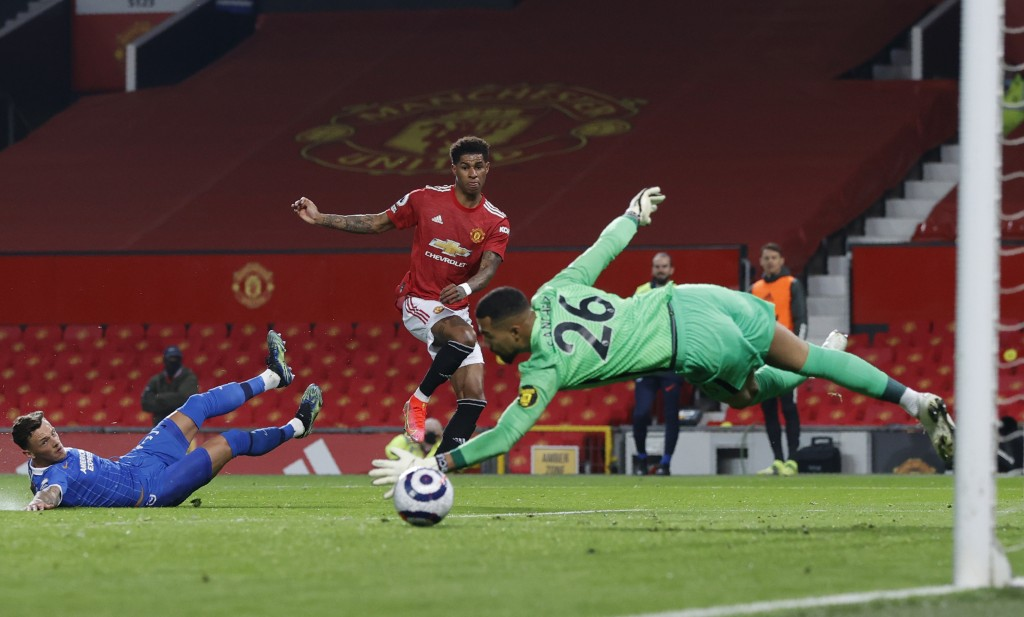 Manchester United's Marcus Rashford, centre, scores his side's opening goal during the English Premier League soccer match between Manchester United a...