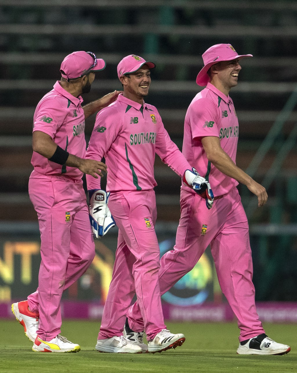 South Africa's wicketkeeper Quinton de Kock, middle, celebrates with teammates after running out Pakistan's batsman Fakhar Zaman for 193 runs during t...