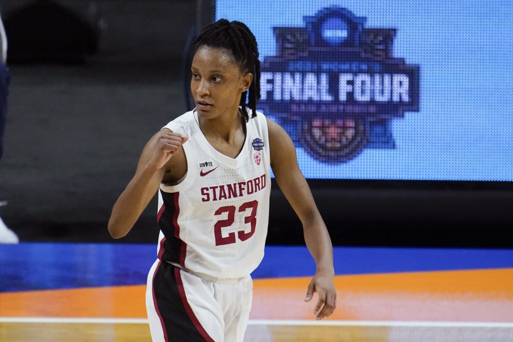 Stanford guard Kiana Williams (23) celebrates during the first half of the championship game against Arizona in the women's Final Four NCAA college ba...