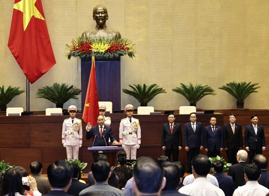 Vietnamese newly elected President Nguyen Xuan Phuc takes an oath in front of the National Assembly in Hanoi, Vietnam on Monday, April 5, 2021.  Vietn...