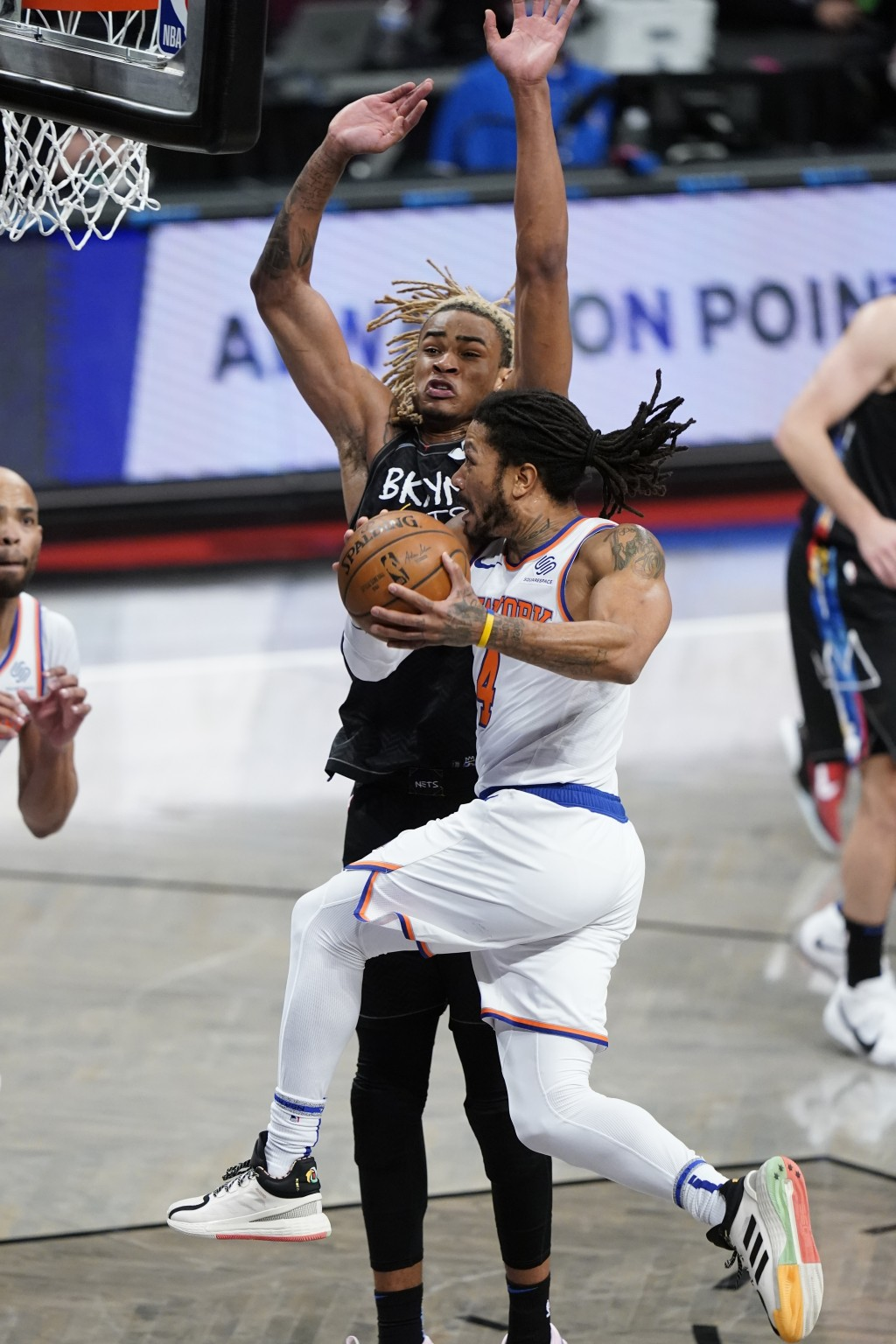 New York Knicks' Derrick Rose (4) drives past Brooklyn Nets' Nicolas Claxton (33) during the second half of an NBA basketball game Monday, April 5, 20...