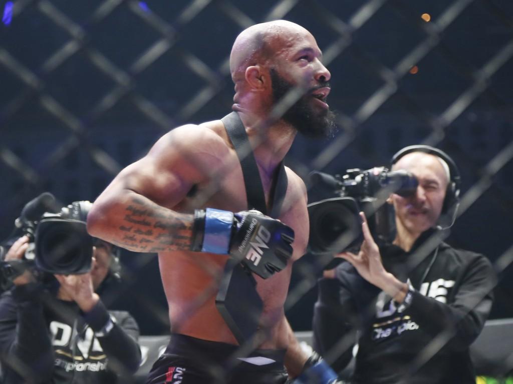FILE - Mixed Martial Arts fighter Demetrious Johnson celebrates after defeating Japan's Yuya Wakamatsu in a flyweight world grand prix quarterfinal On...