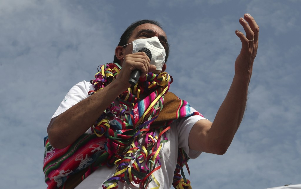 Popular Action party presidential candidate Yonhy Lescano gives a speech as he campaigns at the Caqueta market in Lima, Peru, Monday, April 5, 2021. P...
