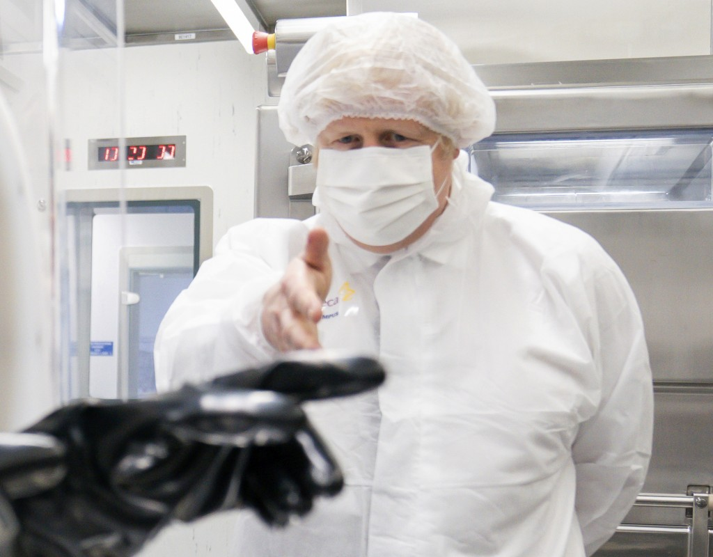 Britain's Prime Minister Boris Johnson visits AstraZeneca facility in Macclesfield, England, on Tuesday April 6, 2021, to learn more about their dolla...