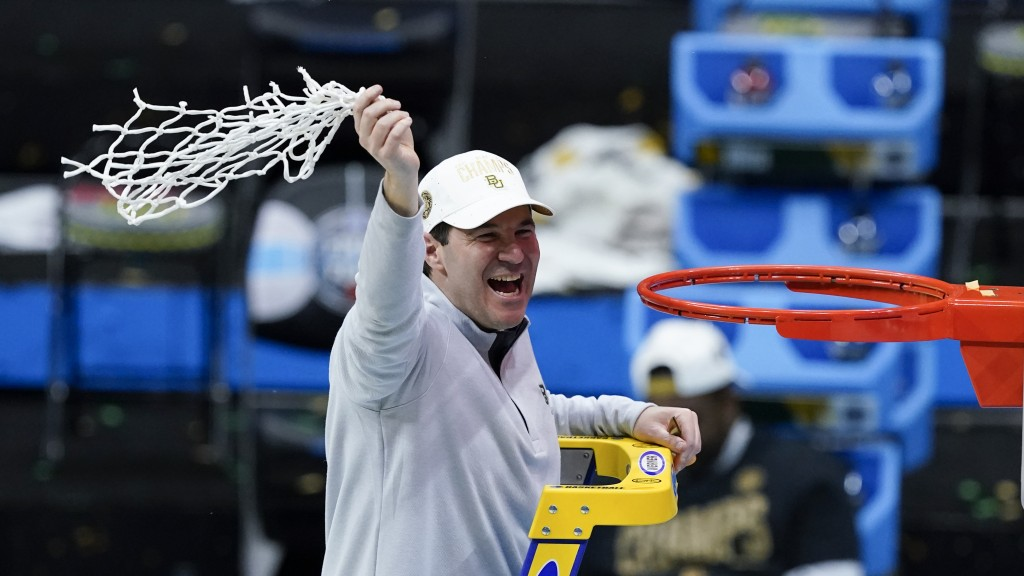 Baylor head coach Scott Drew cuts down the net after the championship game against Gonzaga in the men's Final Four NCAA college basketball tournament,...