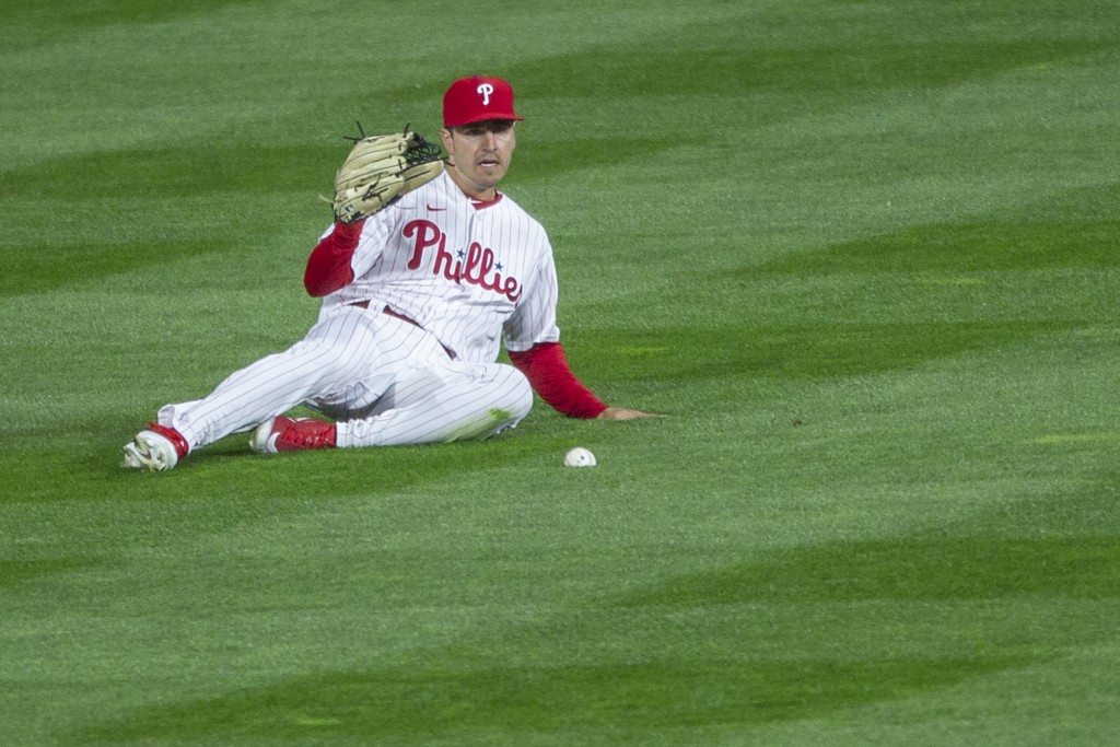 Philadelphia Phillies center fielder Adam Haseley (40) misses a ball hit for a single during the fourth inning of a baseball game, Monday, April 5, 20...