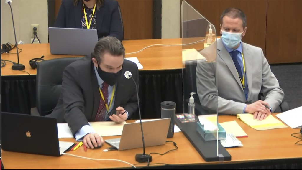 In this image from video, defense attorney Eric Nelson, left, and defendant, former Minneapolis police Officer Derek Chauvin, right, listen as Hennepi...