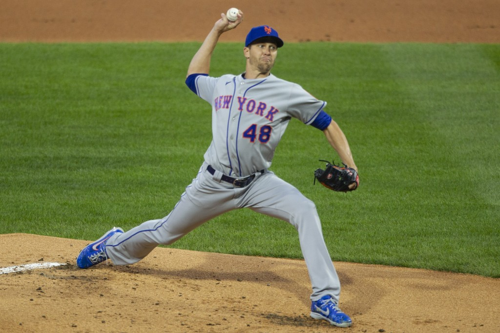 New York Mets starting pitcher Jacob deGrom throws during the first inning of a baseball game against the Philadelphia Phillies, Monday, April 5, 2021...