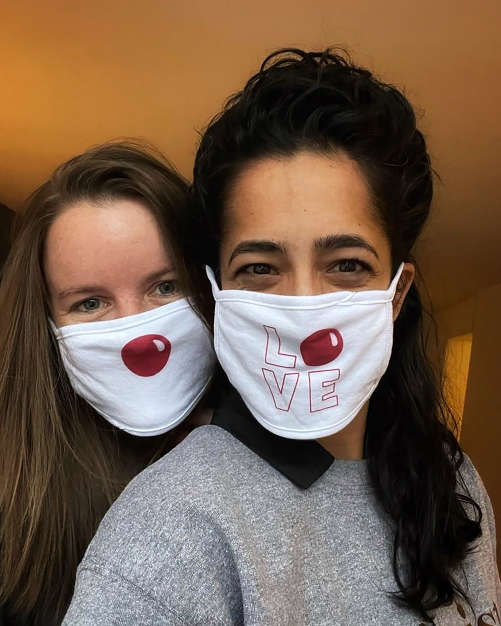 This undated photo provided by Comic Relief's Red Nose Day shows the special Red Nose Day masks that Walgreens employees will wear for the 2021 fundra...