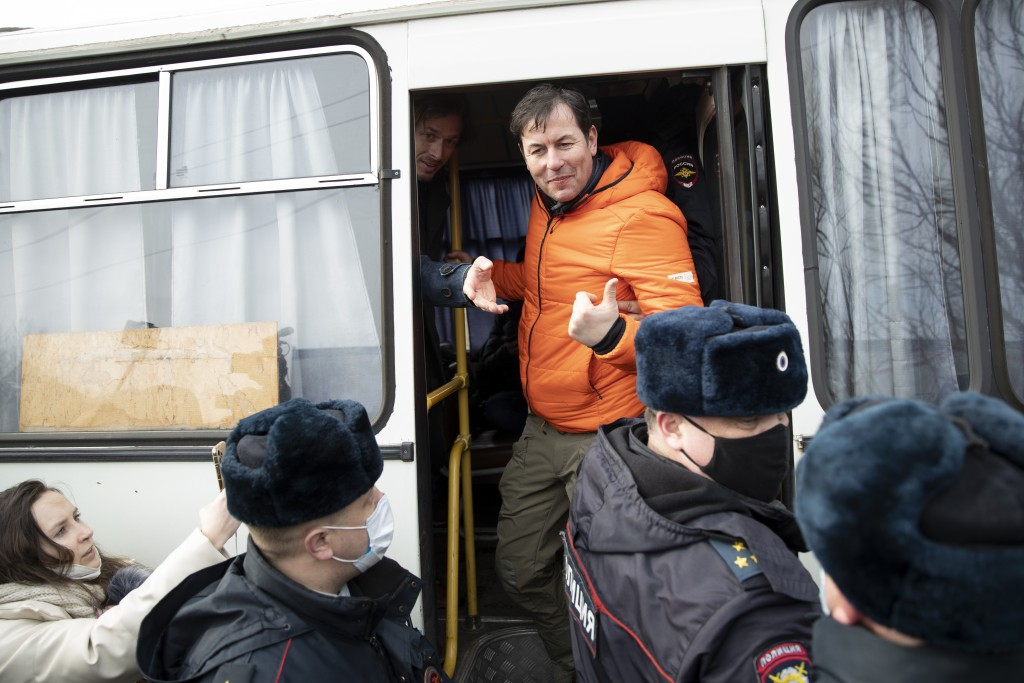 Matthew Chance, CNN Senior International Correspondent in Moscow gestures as police officers detain him at the prison colony IK-2, which stands out am...