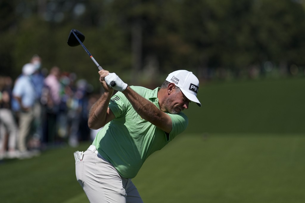 Lee Westwood, of England, hits his tee shot on the first hole during a practice round for the Masters golf tournament on Monday, April 5, 2021, in Aug...
