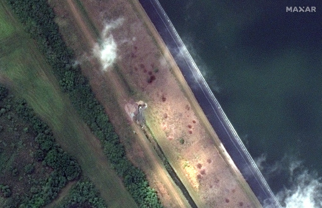 This Monday, April 5, 2021, image provided by Maxar Technologies shows a view of a breach in a retaining pond at the 77-acre Piney Point reservoir in ...