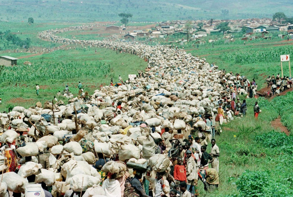 FILE - In this Thursday, Dec. 19, 1996 file photo, tens of thousands of Rwandan refugees, who have been forced by the Tanzanian authorities to return ...