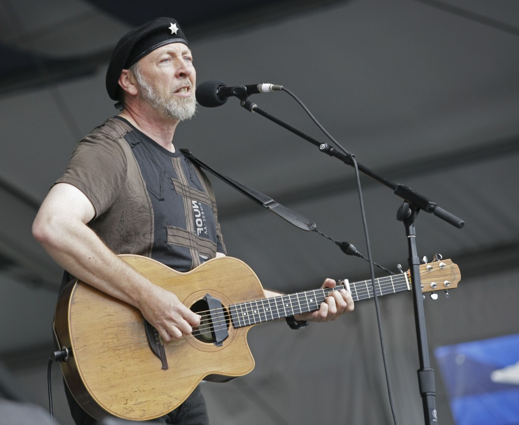 FILE - Richard Thompson performs during the 2008 New Orleans Jazz & Heritage Festival at the New Orleans Fairgrounds Racetrack in New Orleans, on May ...