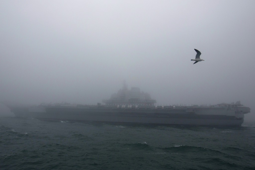 FILE - In this April 23, 2019, file photo, the Chinese People's Liberation Army (PLA) Navy aircraft carrier Liaoning participates in a naval parade to...