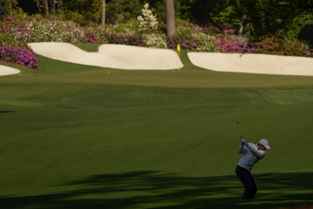 Rory McIlroy, of Northern Ireland, hits from the fairway on the 13th hole during a practice round for the Masters golf tournament on Tuesday, April 6,...