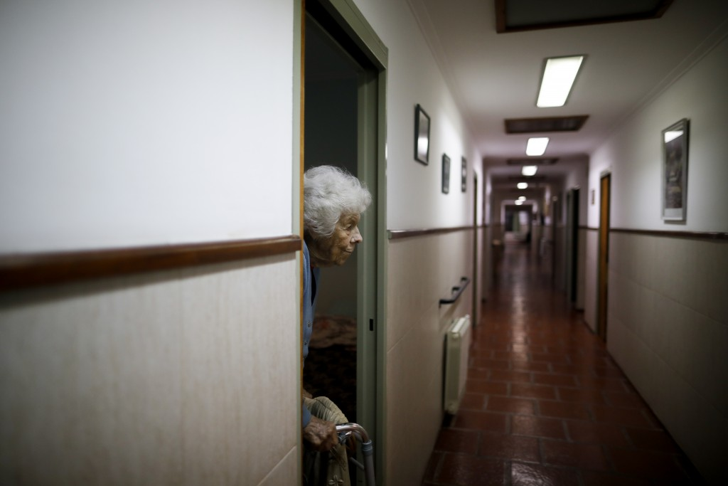 Delia Solbach heads to bed at the Reminiscencias residence in Tandil, Argentina, Sunday, April 4, 2021. Residents here do not have physical contact wi...