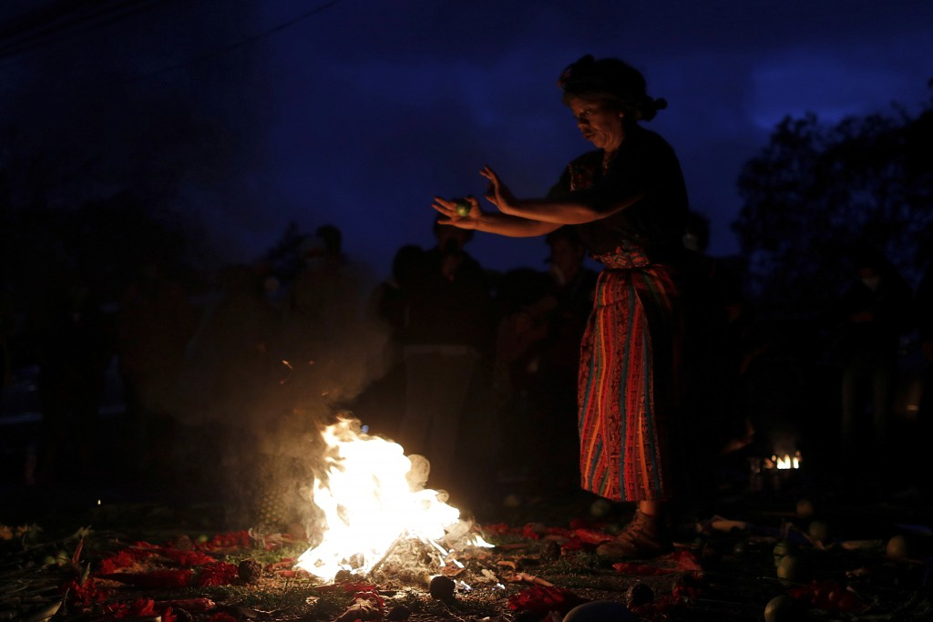 An Indigenous leader prays during a spiritual ceremony before the start of a trial against one of the alleged masterminds of the killing the environme...