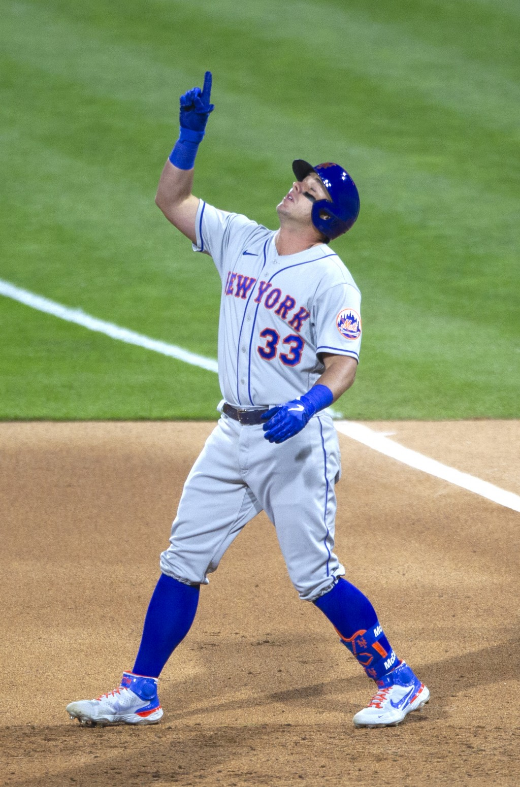 New York Mets James McCann (33) gestures to the sky after hitting an RBI single during the fourth inning of a baseball game against the Philadelphia P...