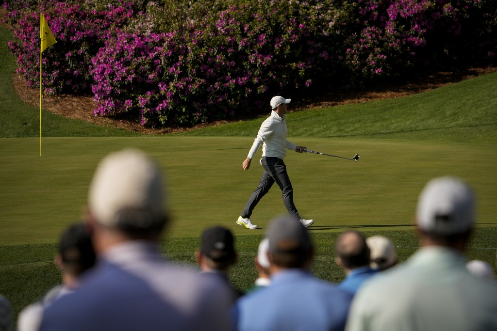Rory McIlroy, of Northern Ireland, walks across the green on the 13th hole during a practice round for the Masters golf tournament on Tuesday, April 6...