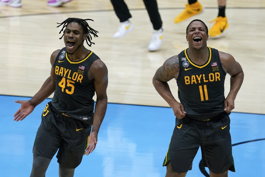 Baylor guard Davion Mitchell (45) and Baylor guard Mark Vital (11) celebrate at the end of the championship game against Gonzaga in the men's Final Fo...