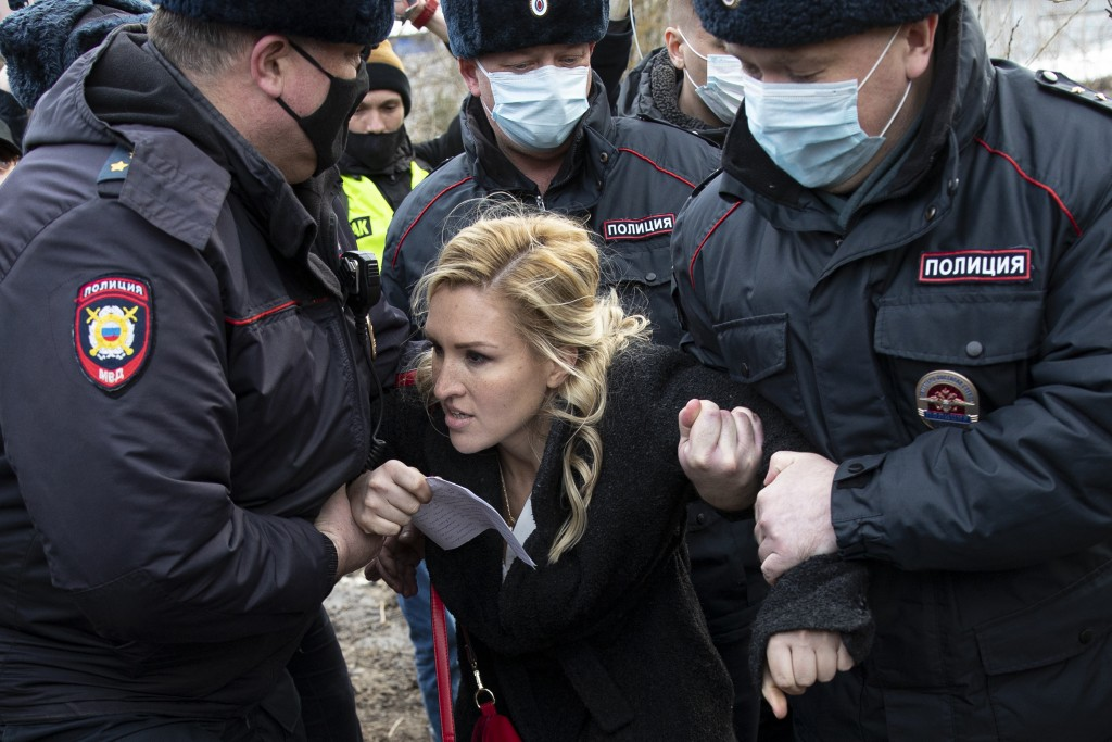 Police officers detain the Alliance of Doctors union's leader Anastasia Vasilyeva at the prison colony IK-2, which stands out among Russian penitentia...