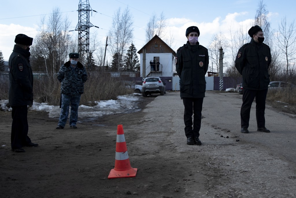 Police officers wearing face masks to protect against coronavirus guard an entrance of the prison colony IK-2, which stands out among Russian penitent...