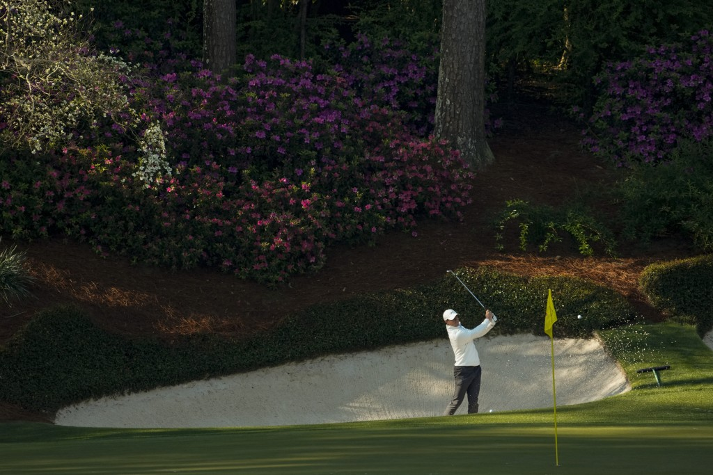 Rory McIlroy, of Northern Ireland, hits from the bunker on the 13th hole during a practice round for the Masters golf tournament on Tuesday, April 6, ...