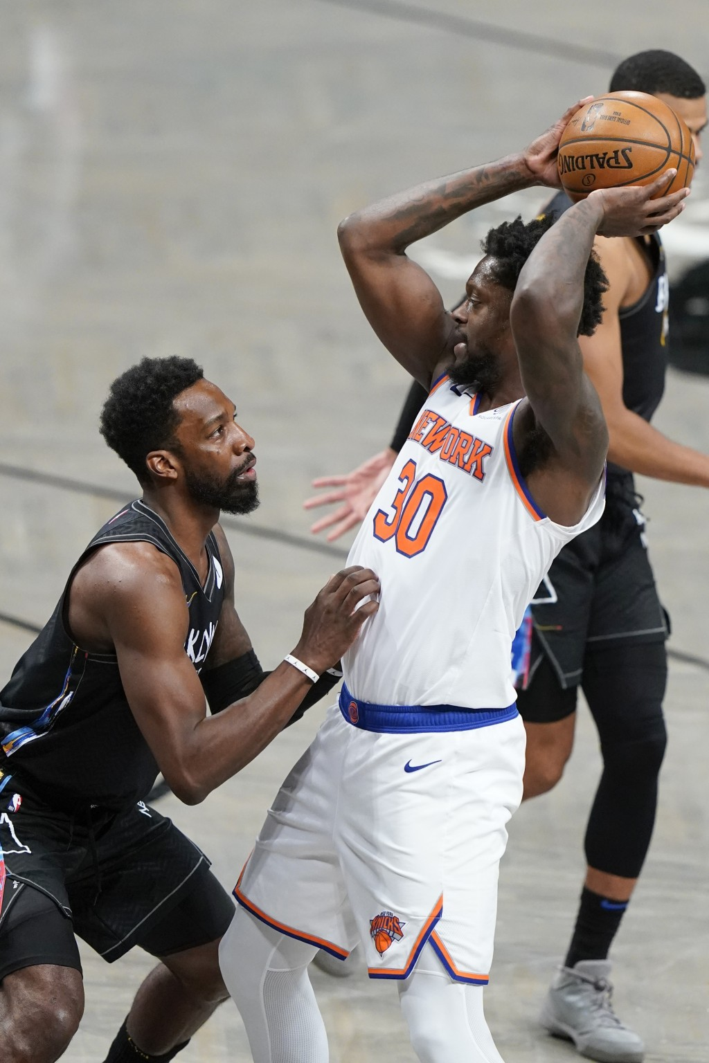 Brooklyn Nets' Jeff Green, left, defends New York Knicks' Julius Randle (30) during the second half of an NBA basketball game Monday, April 5, 2021, i...