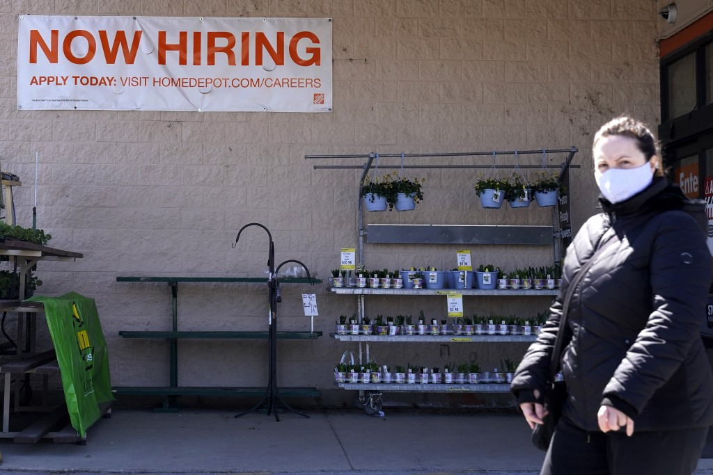 A hiring sign is seen outside home improvement store in Mount Prospect, Ill., Friday, April 2, 2021.  The pace of job openings reached the highest lev...