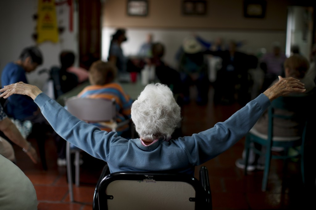 Delia Solbach attends an exercise class at the Reminiscencias residence for the elderly in Tandil, Argentina, Monday, April 5, 2021. Residents here do...