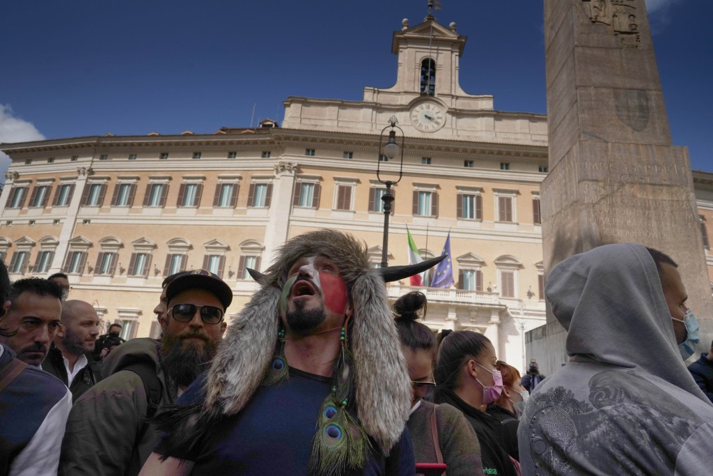 Demonstrators gather outside the lower Chamber during a protest by Restaurant and shop owners in Rome, Tuesday, April 6, 2021. Demonstrators demanded ...