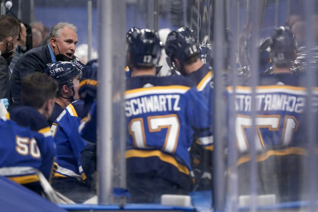 St. Louis Blues head coach Craig Berube, left, talks with his team during the second period of an NHL hockey game against the Vegas Golden Knights Mon...