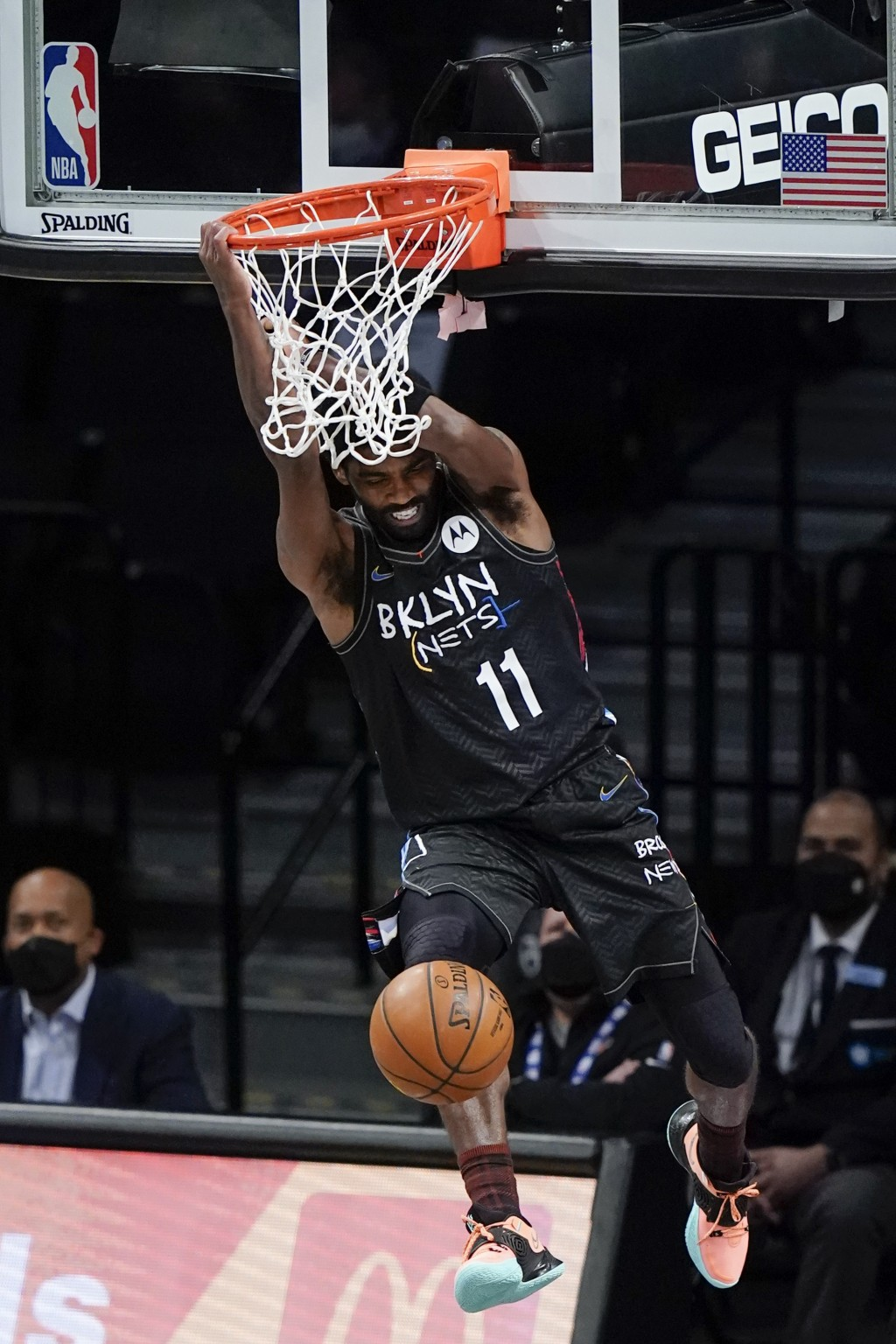 Brooklyn Nets' Kyrie Irving (11) dunks the ball during the second half of an NBA basketball game against the New York Knicks Monday, April 5, 2021, in...