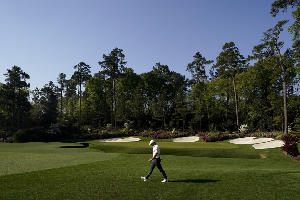 Rory McIlroy, of Northern Ireland, walks on the 14th hole during a practice round for the Masters golf tournament on Tuesday, April 6, 2021, in August...