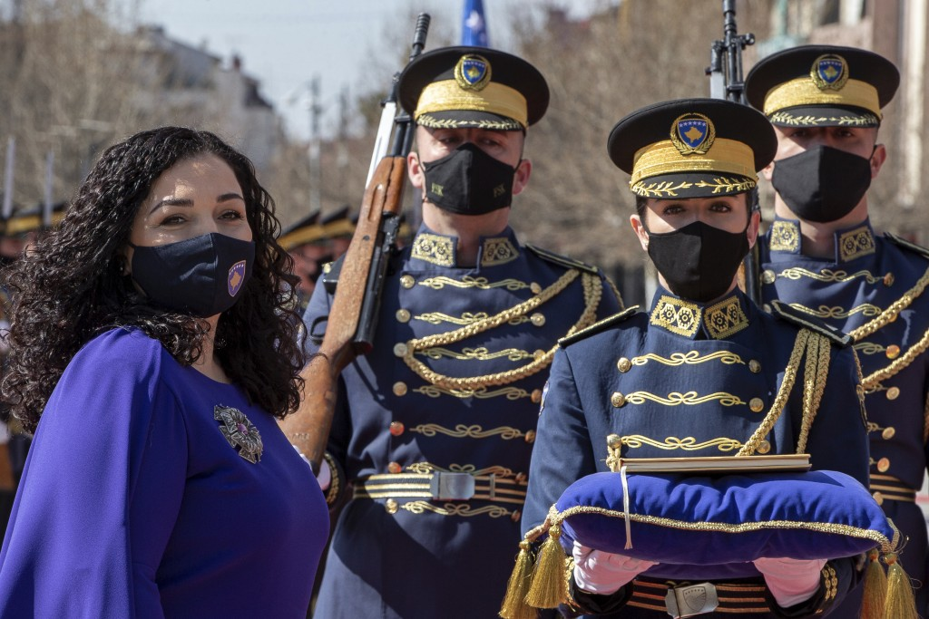 Kosovo newly elected president Vjosa Osmani-Sadriu, as Guard of Honour presents the Kosovo Constitution during a presidential hand over ceremony in ca...