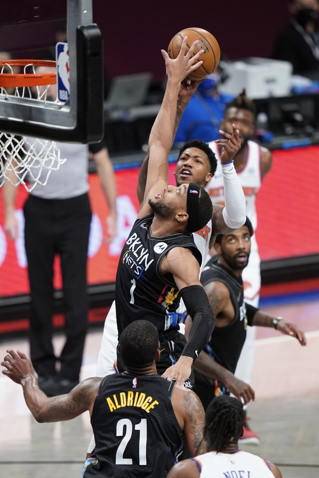 Brooklyn Nets' Bruce Brown (1) blocks a shot by New York Knicks' Elfrid Payton during the second half of an NBA basketball game Monday, April 5, 2021,...