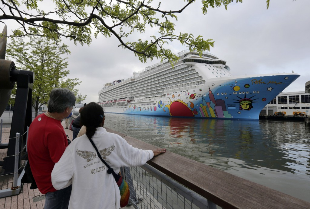 FILE - In this May 8, 2013, file photo, people pause to look at Norwegian Cruise Line's ship, Norwegian Breakaway, on the Hudson River, in New York. O...