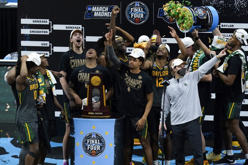 Baylor players and coaches celebrate after the championship game against Gonzaga in the men's Final Four NCAA college basketball tournament, Monday, A...