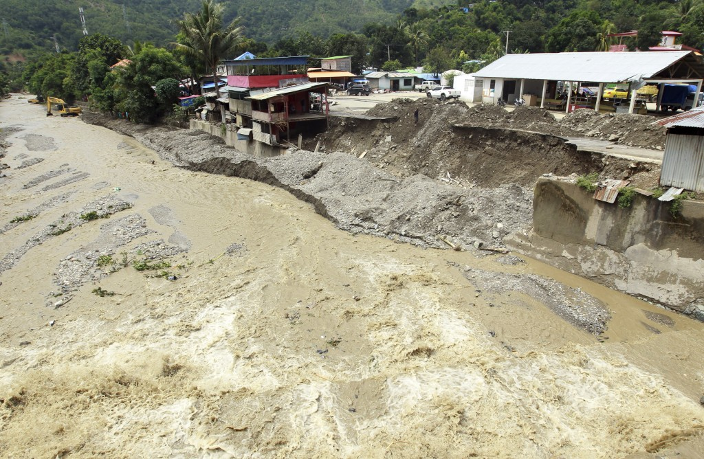 A collapsed retaining wall sits along the banks of a flooded river in Dili, East Timor, Tuesday, April 6, 2021. Several disasters brought on by severe...