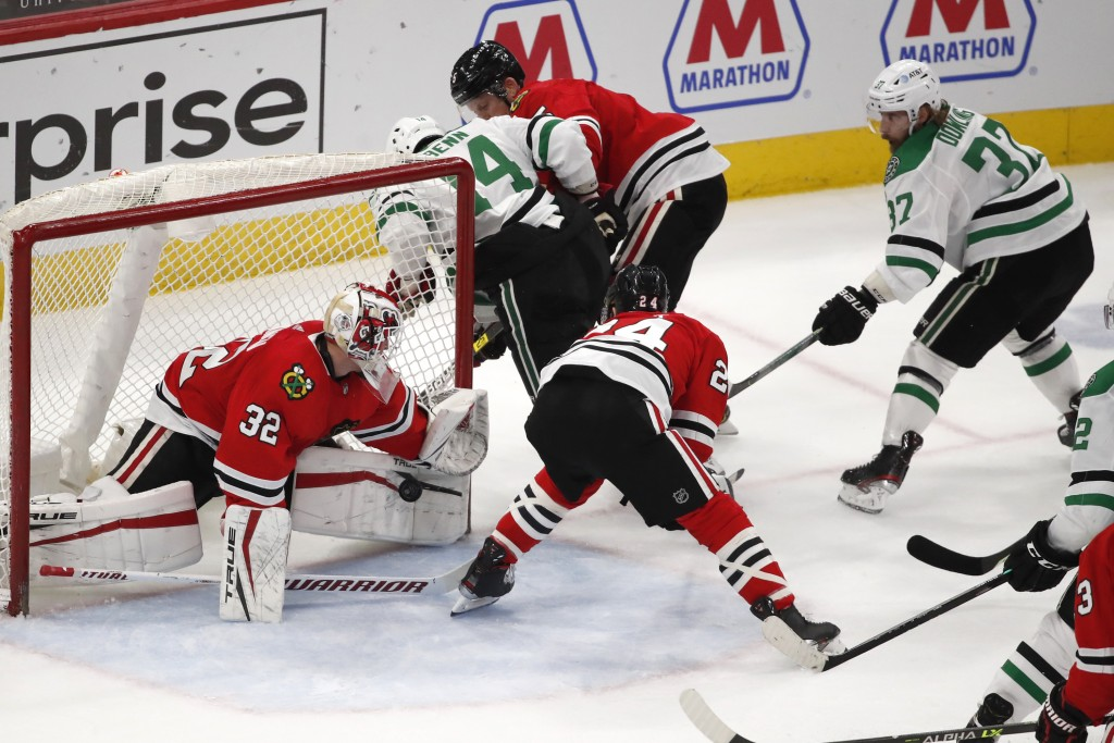 Chicago Blackhawks goaltender Kevin Lankinen (32) stops the shot of Dallas Stars center Justin Dowling (37) during the second period of an NHL hockey ...
