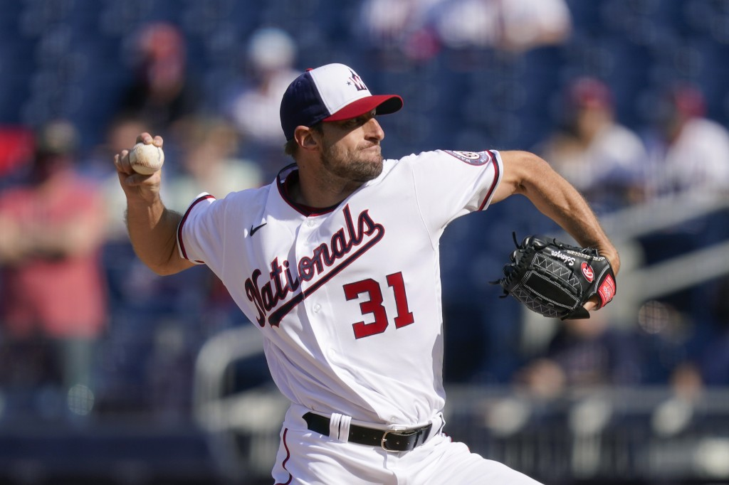 Washington Nationals starting pitcher Max Scherzer throws to the Atlanta Braves in the first inning of an opening day baseball game at Nationals Park,...