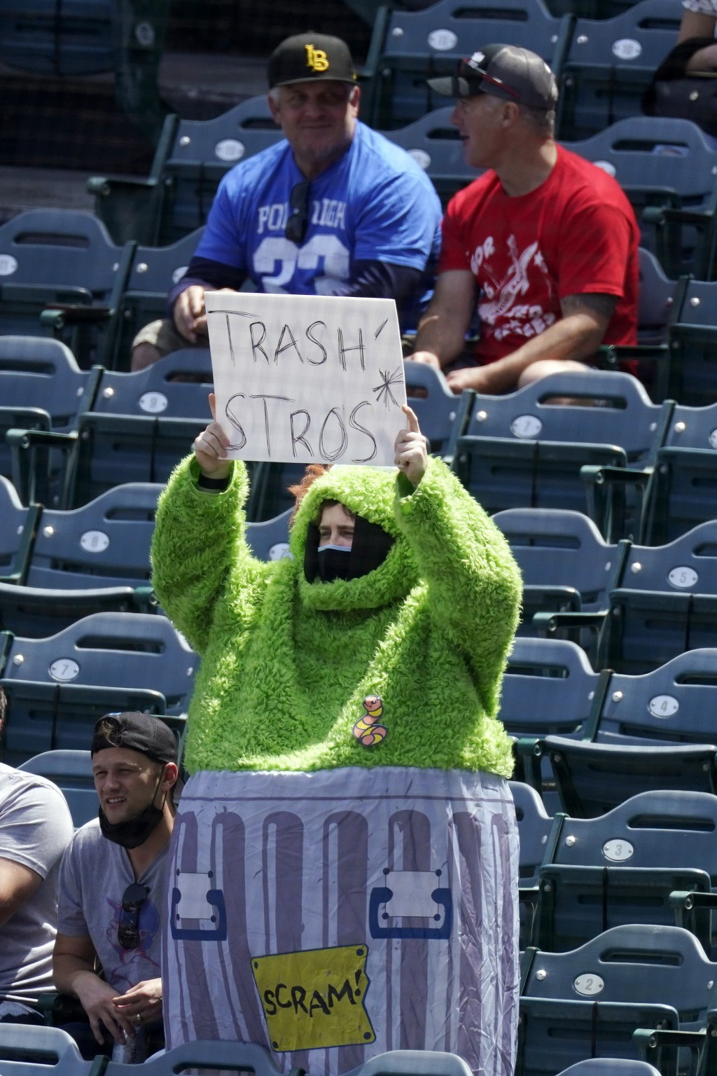 ADDS FULL NAME OF COSTUME - A fan wears an Oscar the Grouch costume as he taunts the Houston Astros prior to a baseball game against the Los Angeles A...