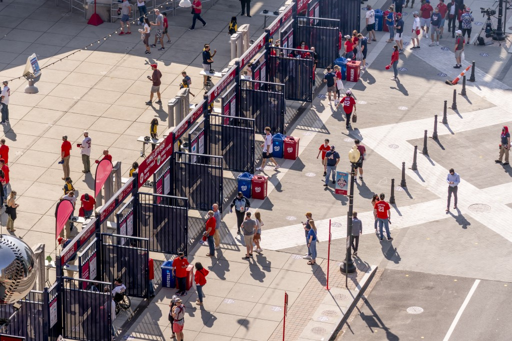 A steady trickle of fans arrive at the centerfield gate as the Washington Nationals play the Atlanta Braves in their opening day baseball game at Nati...