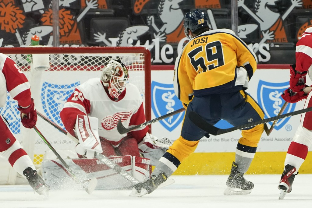 Detroit Red Wings goaltender Thomas Greiss (29) stops a Nashville Predators defenseman Roman Josi (59) shot in overtime during an NHL hockey game Tues...
