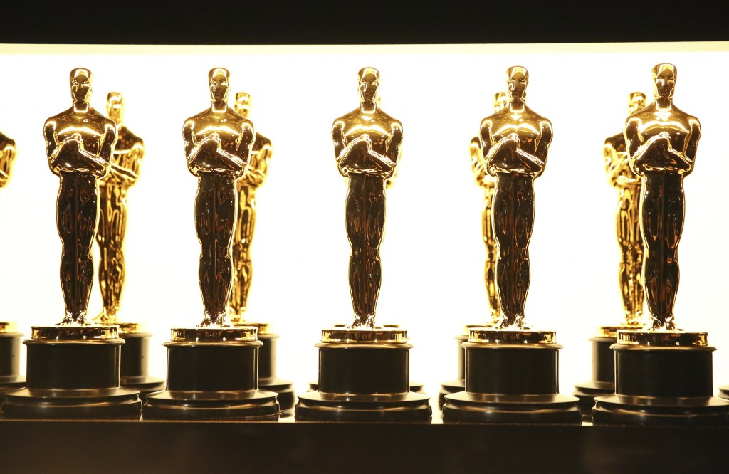 FILE - In this Feb. 26, 2017 file photo, Oscar statuettes appear backstage at the Oscars in Los Angeles. Some people watch awards shows out of love, o...