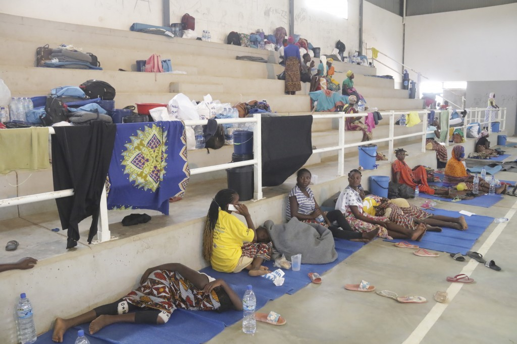 Refugees seek shelter at a centre in Afungi, Mozambique after fleeing attacks in Palma in Northern Mozambique Friday April 2, 2021. Southern African D...