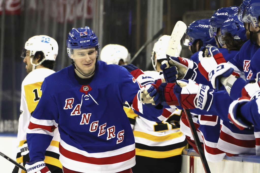 New York Rangers' Kaapo Kakko (24) is congratulated for his third-period goal against the Pittsburgh Penguins in an NHL hockey game Tuesday, April 6, ...